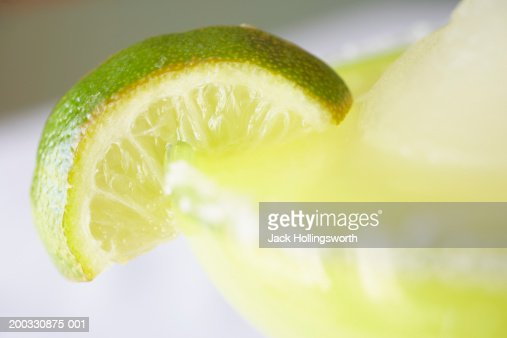 Margarita garnished with lime, close-up (focus on lime)