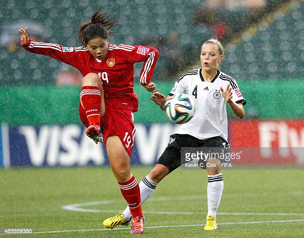 Margarita Gidion of Germany challenges Xiao Yuyi of China PR at Commonwealth Stadium on August 8 2014 in Edmonton Canada