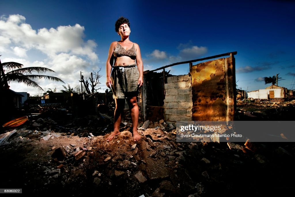 Margarita Velazquez stands atop a pile of rubble of what used to be her home after Hurricane Ike tore through a week earlier September 15 Gibara Cuba...