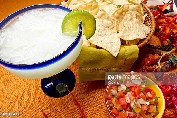 Margarita with lime and chips with salsa