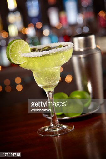 Margarita with salted rim and bokeh bar background