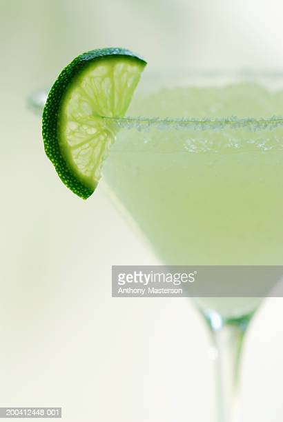 Margarita with slice of lime on rim of glass