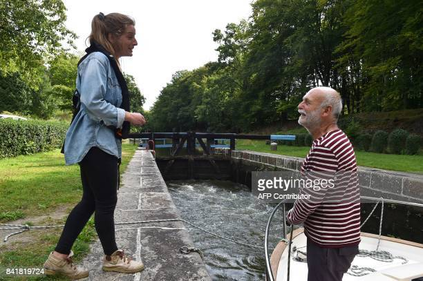 Margaux Roullier a 21yearold French student who works as a lock keeper for the summer talks to a yachtsman at a lock along the Ille and Rance canal...