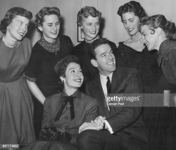 Marge and Gower Champion seated in foreground look over five beauties from the University of Colorado one of whom they've chosen to be queen of the...