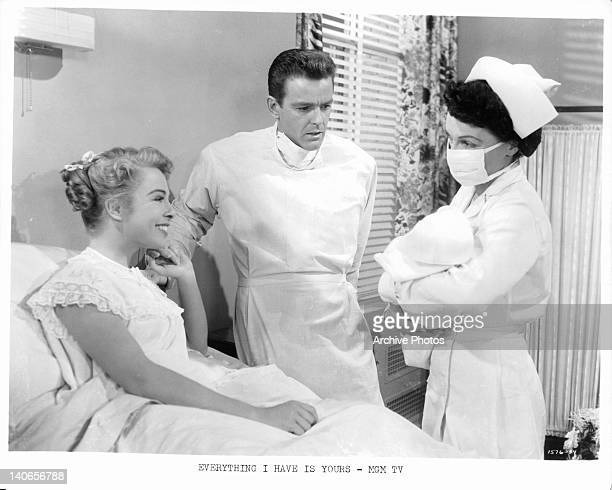 Marge Champion and Gower Champion reacting to nurse holding baby in a scene from the film 'Everything I Have Is Yours' 1952