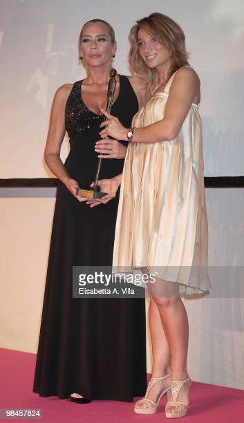 Margherita Granbassi gives the award to actress Barbara De Rossi during the '2010 Premio Afrodite' cerimony at the Studios on April 14 2010 in Rome...