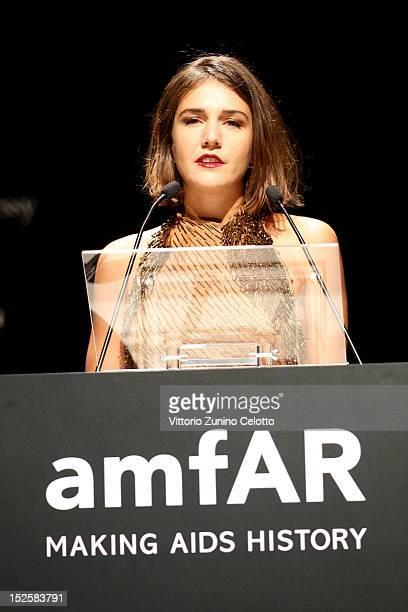 Margherita Missoni speaks on stage at the amfAR Milano 2012 Dinner during Milan Fashion Week at La Permanente on September 22 2012 in Milan Italy