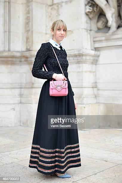 Margherita Rovelli poses wearing a Cos top Vivetta neck vintage skirt and Paula Cademartori bag on Day 7 of Paris Fashion Week Womenswear FW15 on...