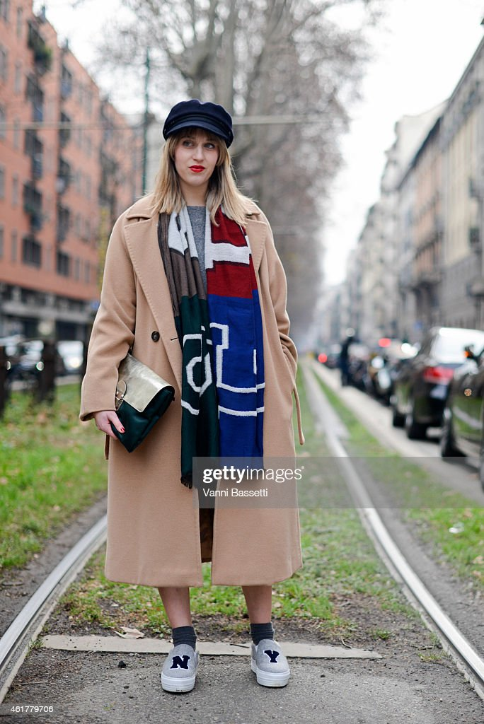 Margherita Rovelli poses wearing a Max Mara coat Eral 55 scarf and Joshua Sanders shoes during day 3 of Milan Menswear Fashion Week Fall/Winter...
