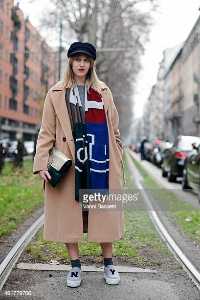 Margherita Rovelli poses wearing a Max Mara coat Eral 55 scarf and Joshua Sanders shoes during day 3 of Milan Menswear Fashion Week Fall/Winter...