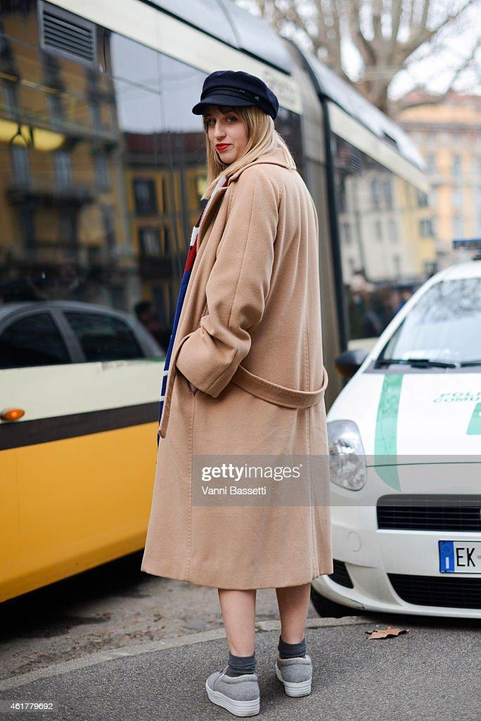 Margherita Rovelli poses wearing a Max Mara coatand Joshua Sanders shoes during day 3 of Milan Menswear Fashion Week Fall/Winter 2015/2016 on January...