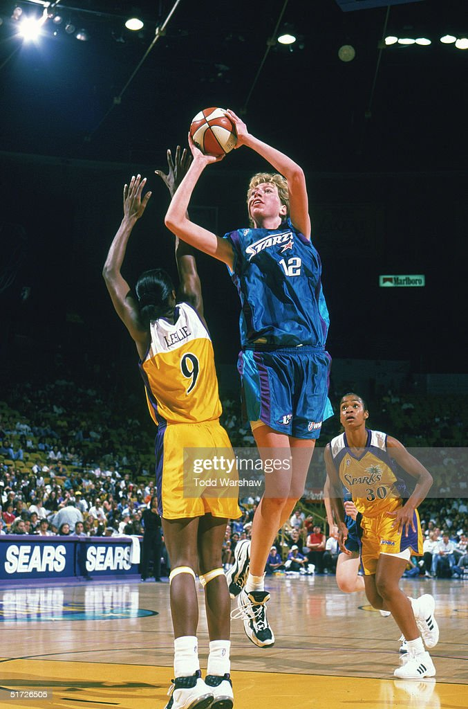 Margo Dydek #12 of the San Antonio Silver Stars goes for the jump shot against Lisa Leslie #9 of the Los Angeles Sparks during a game on July 2, 1998 at the Great Western Forum in Inglewood, California. The Stars won 58-57.