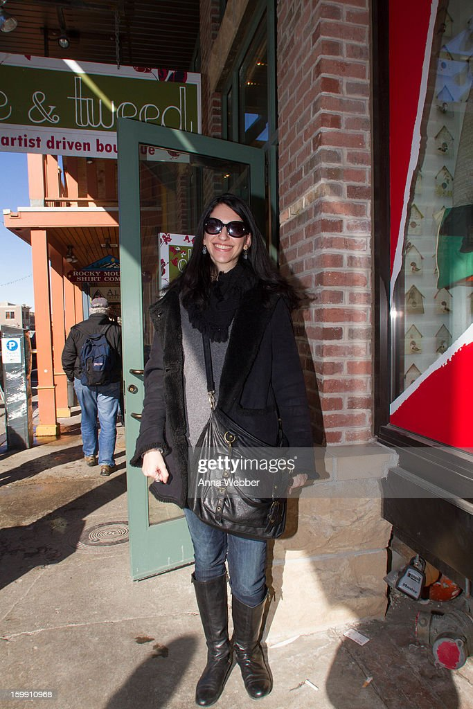 Margo Lipshultz, Book Editor from New York, wearing Urban Outfitters sunglasses, American Eagle scarf, Larry Levine jacket, Old Navy sweater, American Rag purse, Levi's denim jeans, and Nine West boots on January 22, 2013 in Park City, Utah.
