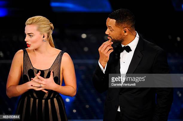 Margot Robbie and Will Smith attend the closing night of 65th Festival di Sanremo 2015 at Teatro Ariston on February 14 2015 in Sanremo Italy