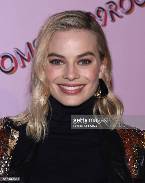 Margot Robbie attends the 29Rooms opening night of 'Refinery 29 Turn it into Art' in ROW DTLA in Los Angeles California on December 6 2017 / AFP...