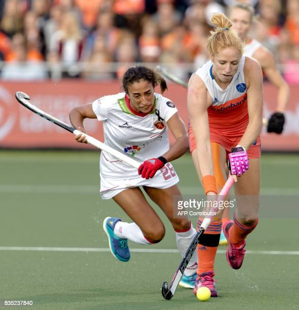 Margot van Geffen of the Netherlands fights for the ball with Marta Segu Rueda of Spain during the women's Rabo Euro Hockey Championships 2017 match...