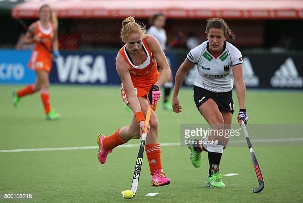 Margot van Geffen of the Netherlands is closed down by Janne MuellerWieland of Germany during the Hockey World League Final Pool A match between the...