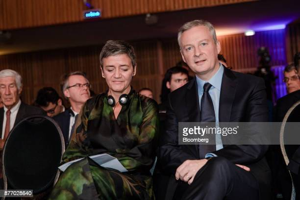 Margrethe Vestager competition commissioner of the European Commission left sits in the audience with Bruno Le Maire France's finance minister during...