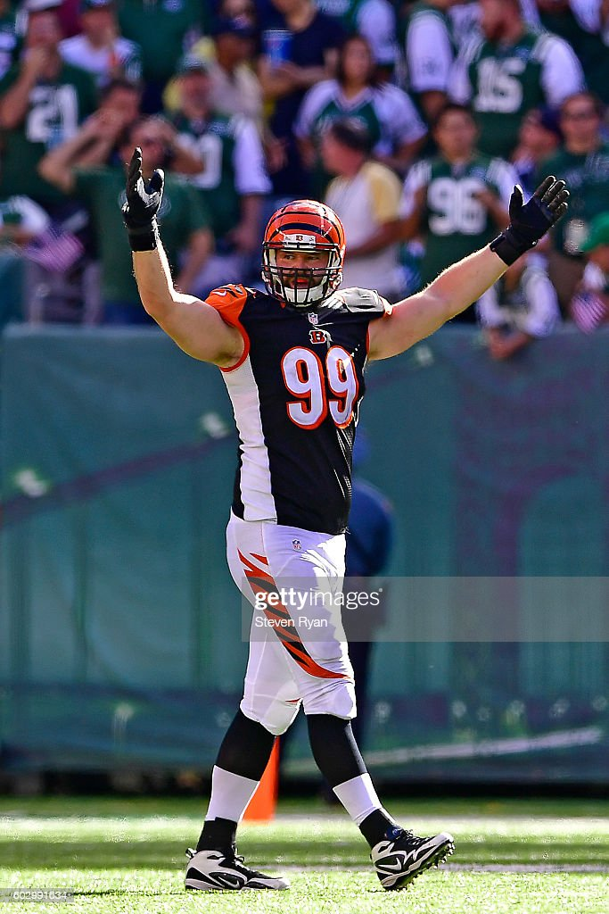 Margus Hunt #99 reacts after teammate Josh Shaw #26 of the Cincinnati Bengals (not shown) intercepts the ball against the New York Jets in the final minute of the fourth quarter at MetLife Stadium on September 11, 2016 in East Rutherford, New Jersey. The Cincinnati Bengals defeated the New York Jets 23-22.