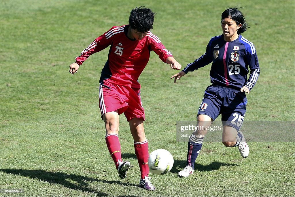 Mari Kawamura of Japan challenges Zhang Rui of China during the Algarve Cup 2013 fifth place match at the Estadio Algarve on March 13, 2013 in Faro, Portugal.