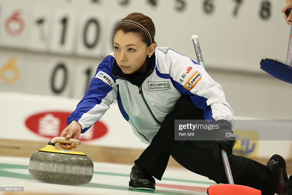 Mari Motohashi of LS Kitami throws a stone during the last day of qualifier for the Curling Japan Qualifying Tournament at Dohgin Curling Stadium on September 14, 2013 in Sapporo, Japan.