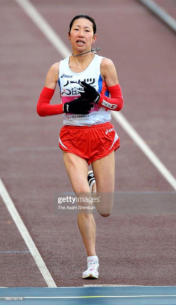 Mari Ozaki of Japan crosses the finishing line as fourth during the 32nd Osaka International Women's Marathon at Nagai Stadium on January 27, 2013 in Osaka, Japan.