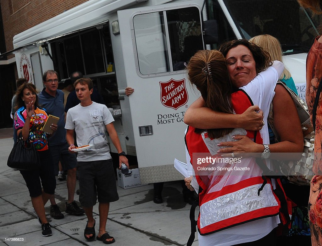 Mari Sinton-Martinez hugs an American Red Cross volunteer on Thursday, June 28, 2012, before the Waldo Canyon Fire impact meeting for residents in Colorado Springs, Colorado, where homes were destroyed on June 26 during the blaze. Sinton-Martinez's home survived the fire.