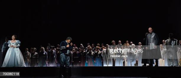 Maria Agresta as Desdemona Jonas Kaufmann as Otello and Marco Vratogna as Iago with artists of the company in the Royal Opera's production of...