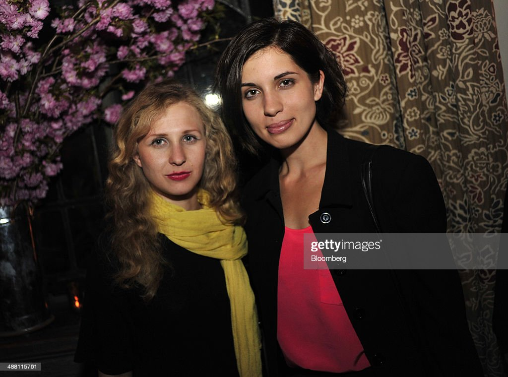<a gi-track='captionPersonalityLinkClicked' href=/galleries/search?phrase=Maria+Alyokhina&family=editorial&specificpeople=9133065 ng-click='$event.stopPropagation()'>Maria Alyokhina</a>, left, and <a gi-track='captionPersonalityLinkClicked' href=/galleries/search?phrase=Nadezhda+Tolokonnikova&family=editorial&specificpeople=9133066 ng-click='$event.stopPropagation()'>Nadezhda Tolokonnikova</a>, members of Pussy Riot, attend the Bloomberg Vanity Fair White House Correspondents' Association (WHCA) dinner afterparty in Washington, D.C., U.S., on Saturday, May 3, 2014. The WHCA, celebrating its 100th anniversary, raises money for scholarships and honors the recipients of the organization's journalism awards. Photographer: Pete Marovich/Bloomberg via Getty Images