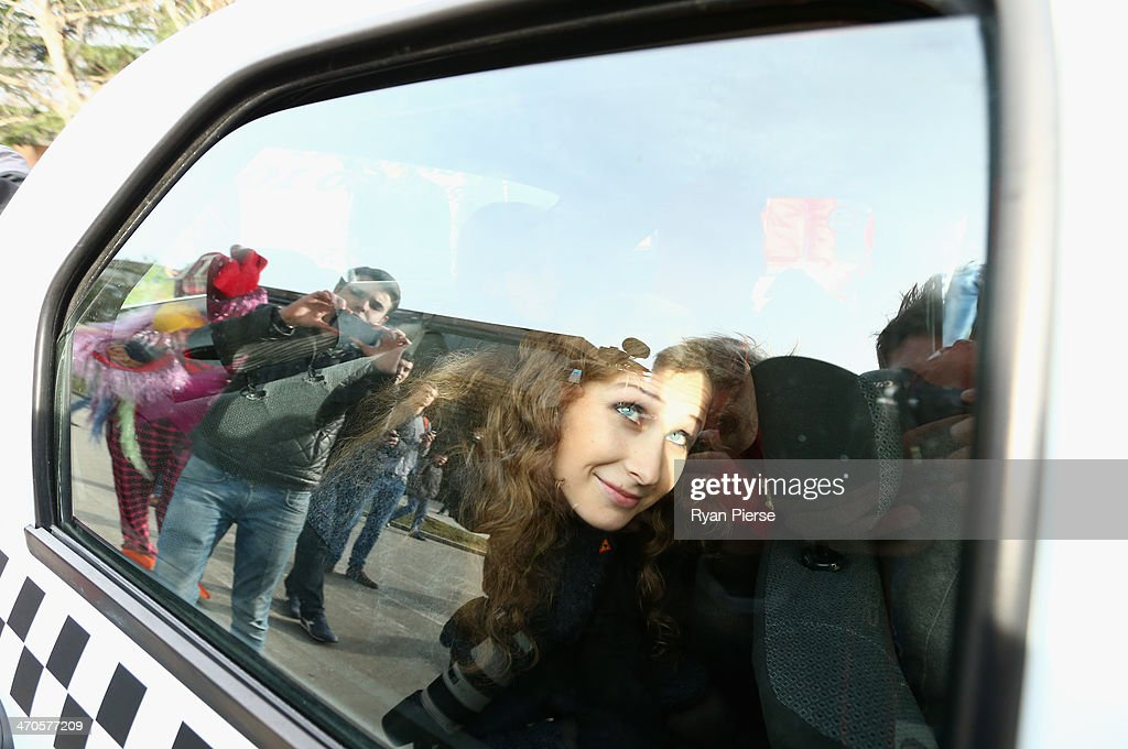 Maria Alyokhina, member of protest group Pussy Riot leaves after a press conference on February 20, 2014 in Sochi, Russia.