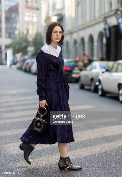Maria Barteczko wearing a blue maxi dress Diane von Fuerstenberg blue bracelet bag Chloe blue ankle boots with studs Chloe white shirt Acne Ray Ban...