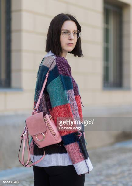 Maria Barteczko wearing patchwork oversized wool sweater Stella McCartney black skinny jeans Madewell red buckle boots with studs Givenchy silver...