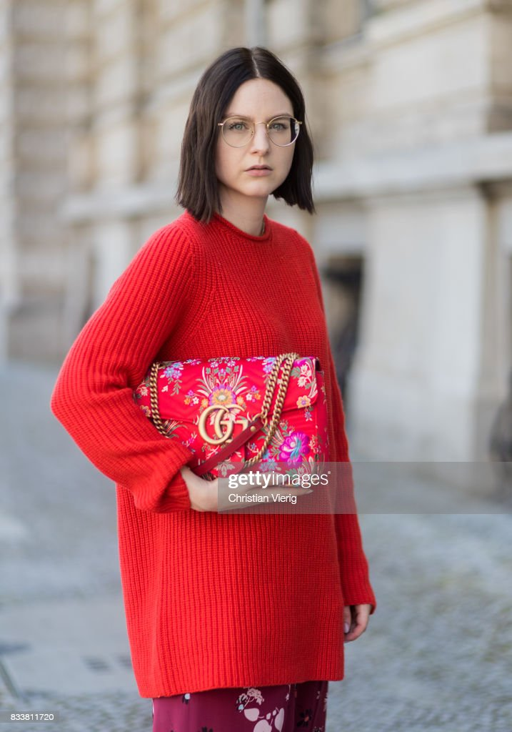 Maria Barteczko wearing red oversized wool sweater The Row, flared floral trousers Valentino, black heels Gianvito Rossi, red GG Marmont flower printed bag Gucci, round golden glasses Ray Ban on August 17, 2017 in Berlin, Germany.