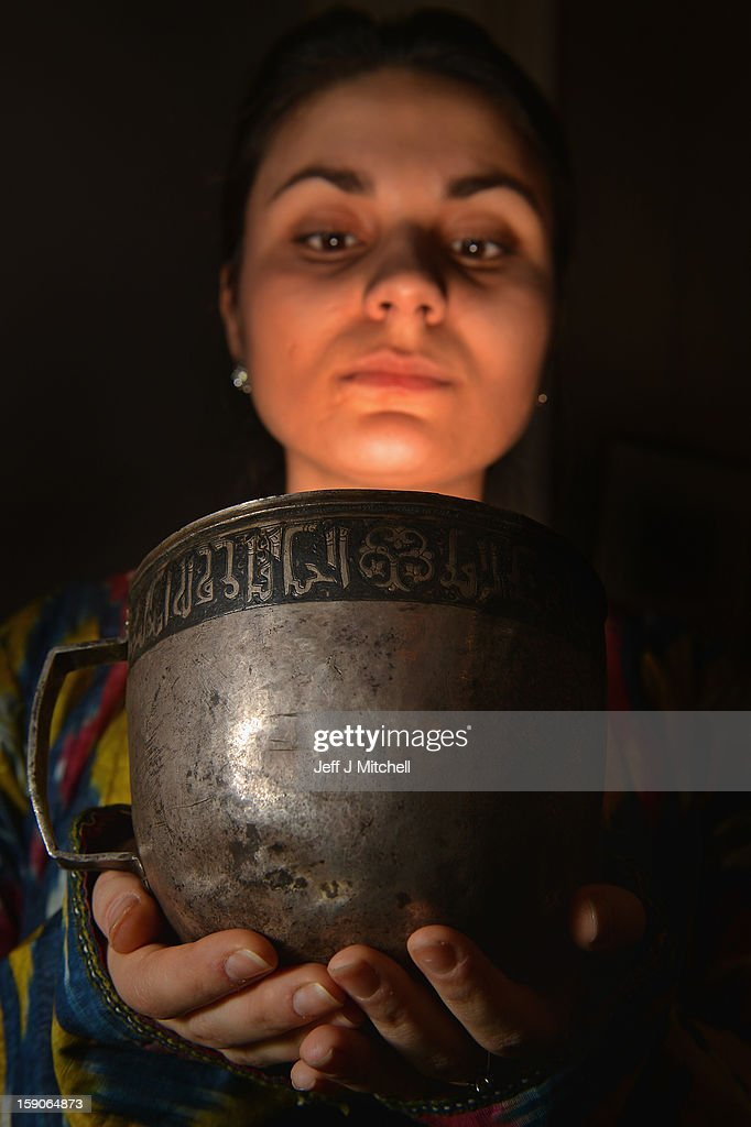 Maria Baskhanova of Bonham's holds an a silver goblet from the early Islamic period, between 1059 and1074 at an Islamic Art Exhibition at Bonham's on January 7, 2013 in Edinburgh, Scotland. The private collection of Islamic Art is due to be exhibited from January 8 - 13th at Bonham's in Edinburgh. This collection has never been seen in public before and is Scotland's largest private and internationally important collection of Islamic art including over 650 items from pre-Islamic and Islamic culture. Primarily featuring objects from the Land of Timur, Central Asia; those on display are ancient ceramics, bronzes, books, goblets, glass, furniture, paintings, textiles and coins.