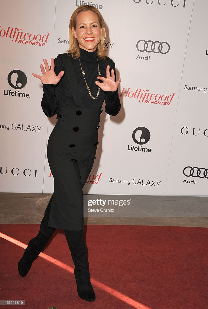 Maria Bello arrives at the The Hollywood Reporter's Women In Entertainment Breakfast Honoring Oprah Winfrey at Beverly Hills Hotel on December 11, 2013 in Beverly Hills, California.