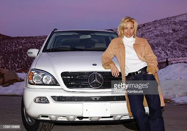 Maria Bello poses with the 2003 MercedesBenz ML 350