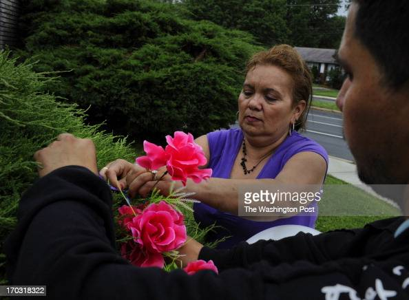 Maria Blanca and Luis Francisco placed flowers and balloons in remembrance of the 3 people who died in a violent car crash the night before They are...