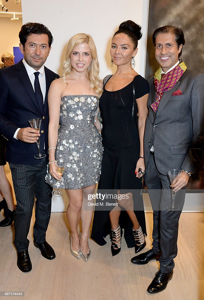 Maria Bogdanovich and Miranda Miranishvilli (C) attend the launch party for Phillips European Headquarters at 30 Berkeley Square on October 13, 2014 in London, England.