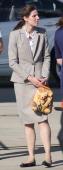 Maria Borrallo Prince George's nanny holds a kangaroo bag as Prince William Duke of Cambridge Prince George of Cambridge and Catherine Duchess of...