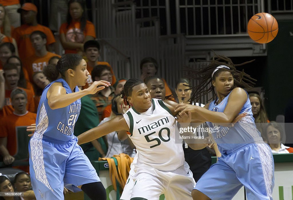 Maria Brown of Miami battles Krista Gross (21) and Tierra Ruffin-Pratt of North Carolina for a loose ball during a women's college basketball game at the BankUnited Center in Coral Gables, Florida, Sunday, January 27, 2013.