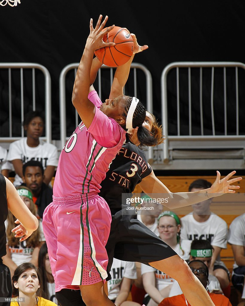 Maria Brown #50 of the Miami Hurricanes and Alexa Deluzio #3 of the Florida State Seminoles battle for a rebound on February 10, 2013 at the BankUnited Center in Coral Gables, Florida. The Seminoles defeated the Hurricanes 93-78.