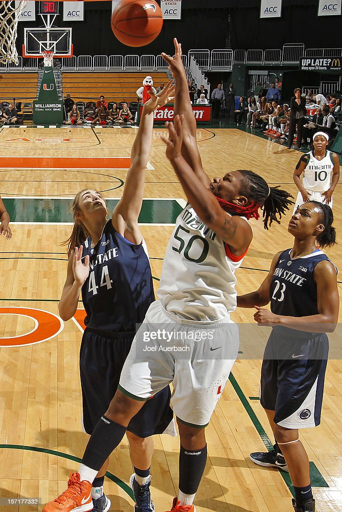 Maria Brown #50 of the Miami Hurricanes and Tori Waldner #44 of the Penn State Lady Lions battle for a rebound on November 29, 2012 at the BankUnited Center in Coral Gables, Florida. Miami defeated Penn State 69-65.