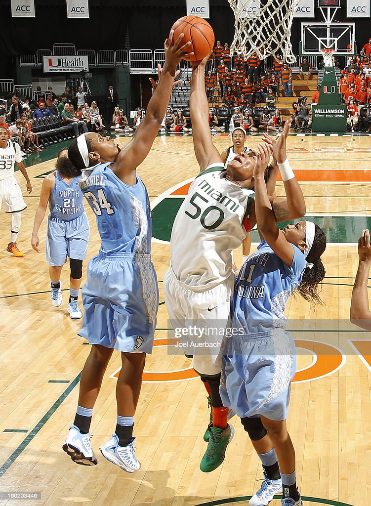 Maria Brown #50 of the Miami Hurricanes and Xylina McDaniel #34 of the North Carolina Tar Heels fight for control of the rebound on January 27, 2013 at the BankUnited Center in Coral Gables, Florida. The Tar heels defeated the hurricanes 64-62.