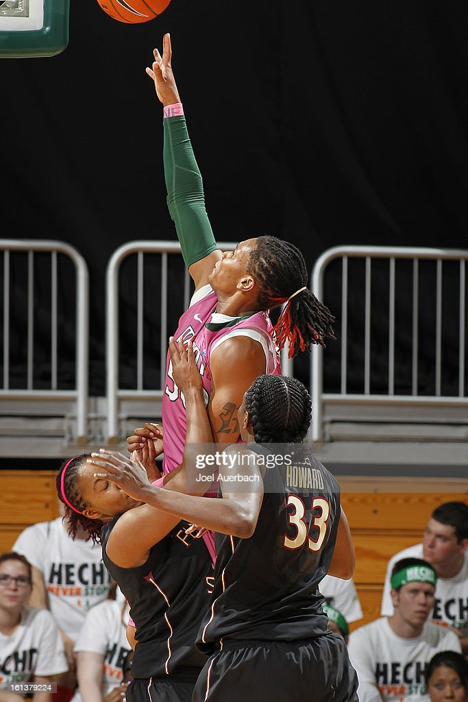 Maria Brown #50 of the Miami Hurricanes is unable to score as she attempts to split the Florida State Seminoles defense on February 10, 2013 at the BankUnited Center in Coral Gables, Florida. The Seminoles defeated the Hurricanes 93-78.