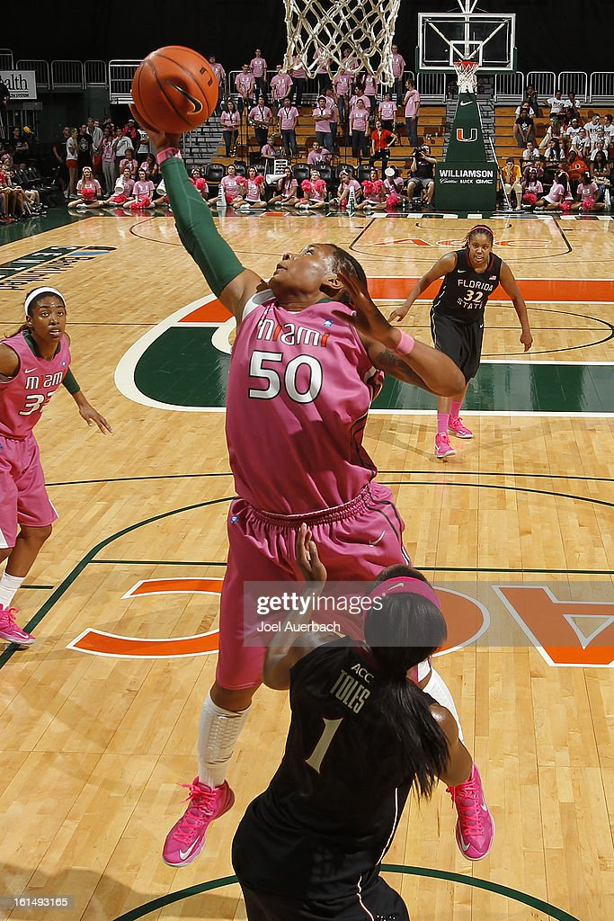 Maria Brown #50 of the Miami Hurricanes takes a defensive rebound over Morgan Toles #1 of the Florida State Seminoles on February 10, 2013 at the BankUnited Center in Coral Gables, Florida. The Seminoles defeated the Hurricanes 93-78.