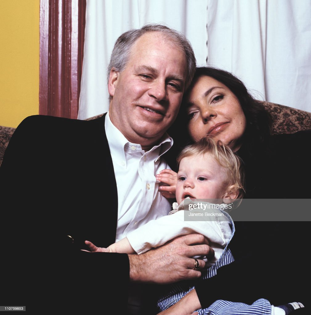 Maria Burton, the adopted daughter of Elizabeth Taylor and Richard Burton, at home with her husband and child in New Jersey, 2003.