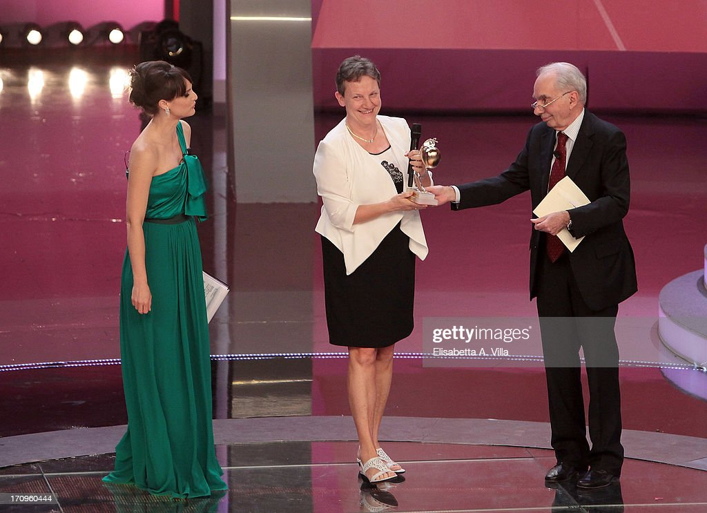 Maria Cannata (C) receives Bellisario award from Antonio Amato (R) during the Premio Bellisario 2013 at Dear RAI studios on June 20, 2013 in Rome, Italy.