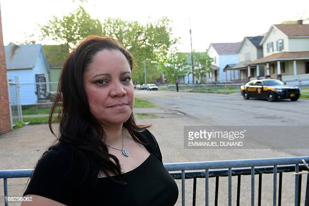 Maria CastroMontes a cousin of the Castro brothers suspected of holding three women captive for a decade talks to the press near the house where the...