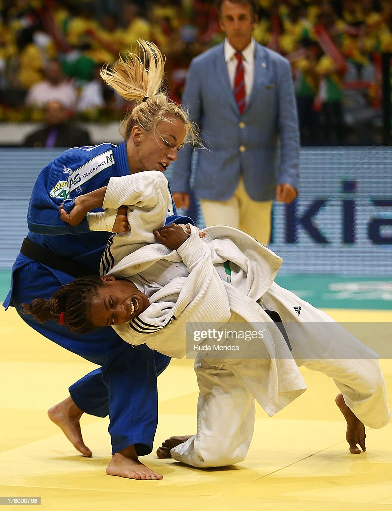 Maria Celia Laborde of Cuba (white) fights against <a gi-track='captionPersonalityLinkClicked' href=/galleries/search?phrase=Charline+Van+Snick&family=editorial&specificpeople=6586925 ng-click='$event.stopPropagation()'>Charline Van Snick</a> of Belgium in the -48 kg category during the World Judo Championships at the Maracanazinho gymnasium on August 26, 2013 in Rio de Janeiro, Brazil.