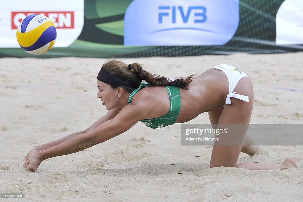 Maria Clara Salgado Rufino of Brazil saves the ball during Day 2 of the FIVB World Championships on July 2, 2013 in Stare Jablonki, Poland.